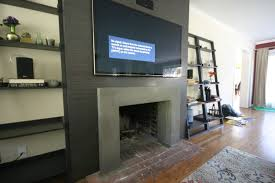 concrete fireplace surround and laminate surround floor tile was