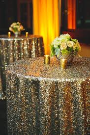 New Years Eve Masquerade Decorations by Glittering Gold Tablecloths Weddings Wedding And Gold Tablecloth