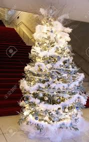 christmas tree decorated with in silver blue and white stock
