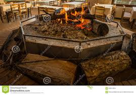 fire burning in round central fireplace stock photo image 63844006