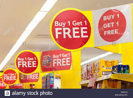buy one get one free and special offers signs at tesco stock