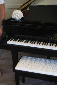 white piano bench with storage bench decoration