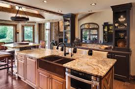 kitchen industrial pendant lighting also wooden base cabinets full image for round chandelier also funky island sink design feat rustic stone kitchen backsplash and