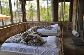 pleasant a pair of hanging bed in rustic enclosed porch with