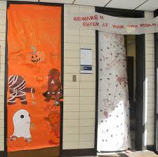 halloween rugs behavioral and social science students decorate doors for