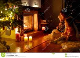 happy family by a fireplace on christmas stock photo image 42443446