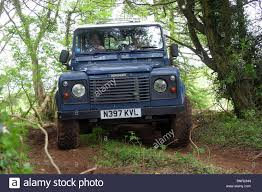 land rover 110 off road land rover 110 defender driving off road stock photo royalty free