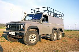 tan land rover photography and journey foley 6x6 130 land rover defender