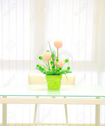 artificial flower in vase on mirror desk stock photo picture and