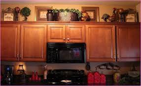 kitchen cabinets decorating ideas above kitchen cabinet decor ideas kitchenstircom