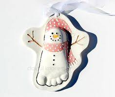 this snowman foot ornament orders of and