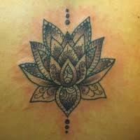 black tribal lotus flower on back tattooimages biz