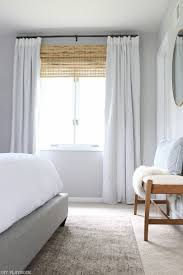 how to hang curtains high and wide to make your window appear