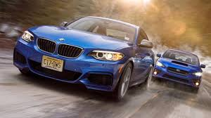 subaru galaxy blue the bmw 235i takes on the subaru wrx sti