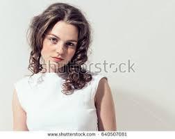 portrait studio beautiful girl curly hair white dress stock photo 640507081