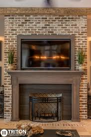Country Living Room Ideas With Fireplace And Tv Reclaimed Brick Fireplace Also Provided Reclaimed Beams Mantel