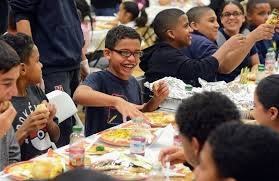 club serves up early thanksgiving for children