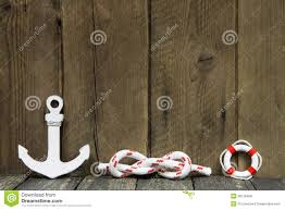 Nautical Decoration by Nautical Decoration With Anchor And Knot On Wood Royalty Free