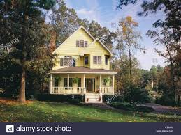 House With A Porch Charming Two Story Yellow House With A Large Front Porch On Wooded