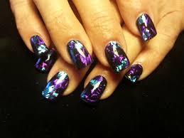 black gel polish over acrylic tips with fabulous nail art foil