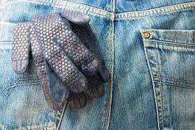 working glove in the back pocket of old used jeans stock photo