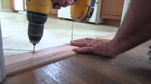 How To Put Laminate Flooring Down How To Install An Oak Threshold Youtube