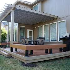 low level timbertech deck with built in benches and pergola