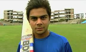 when 18 year virat kohli with a bat in treaded