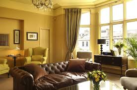 home design with yellow walls interior modern dark yellow living room wall color design idea