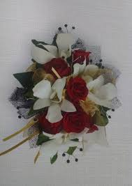 red rose and orchid wrist corsage and boutiner in wamego ks the