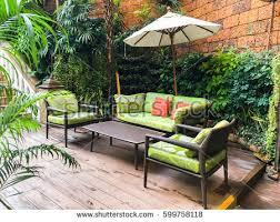 bali style coffee table cozy sofa coffee table umbrella garden stock photo royalty free