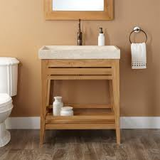 wooden vanity with white granite top trough sink bathroom