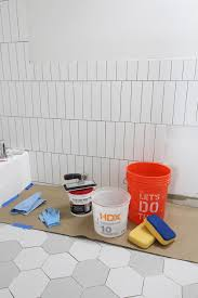 colored grout and new tile create fresh bathroom look
