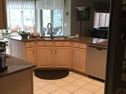 what color paint goes with brown cabinets brown quartz countertops what color cabinet paint