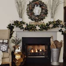 home for the holidays blog tour 2 ladies a chair style 2 there is so much activity in this room that i ve kept the decor simple and natural around the fireplace just greens whites sparkles