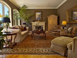 traditional armoire taupe living room gold mirror dark walls