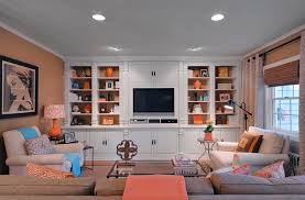 orange brown den with pops of aqua custom bookselves orange you