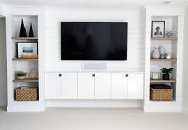 built in tv wall the ultimate guide to decorating a tv wall jessica devlin design