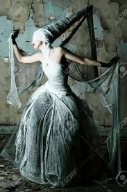 shot of a twilight in white dress halloween horror stock
