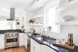 white cabinets with black countertops and backsplash white kitchen cabinets and countertops a style guide