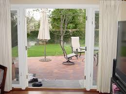 white stained wooden sliding patio glass door using ivory curtain