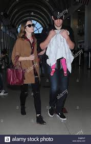 emily blunt and family arrive at los angeles international airport