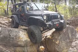 jeep wrangler truck watch this jeep wrangler put its truck wheels to work