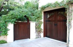 shed architectural style garage doors and entry gates designed to match in a european
