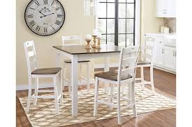 woodanville counter height dining room table and bar stools set