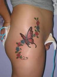 flowers and butterfly image on hip from itattooz