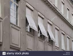buildings facade windows venetian blinds old gray detail stock