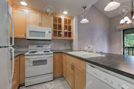 gray kitchen cabinets white appliances tidy compact kitchen with maple cabinets grey counters