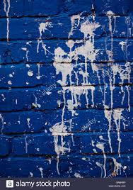 dark blue brick wall pattern background with white paint plashes