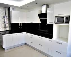 modern open kitchen design with white glossy cabinet and black